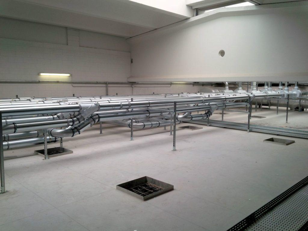 Linee di tubazione rifili con automazione per selezione del punto di scarico in base ai materiali.